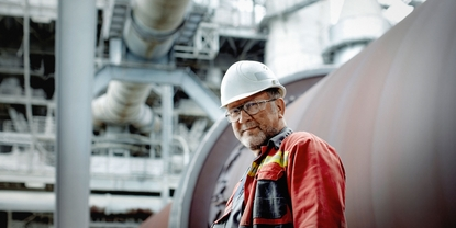 Engineer in front of a cement kiln